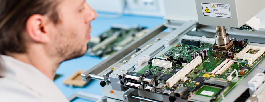 Trained employees carry out repair work on industrial electronics.